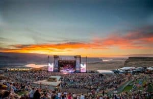 The Gorge Amphitheatre with the Sun setting onthe river behind it
