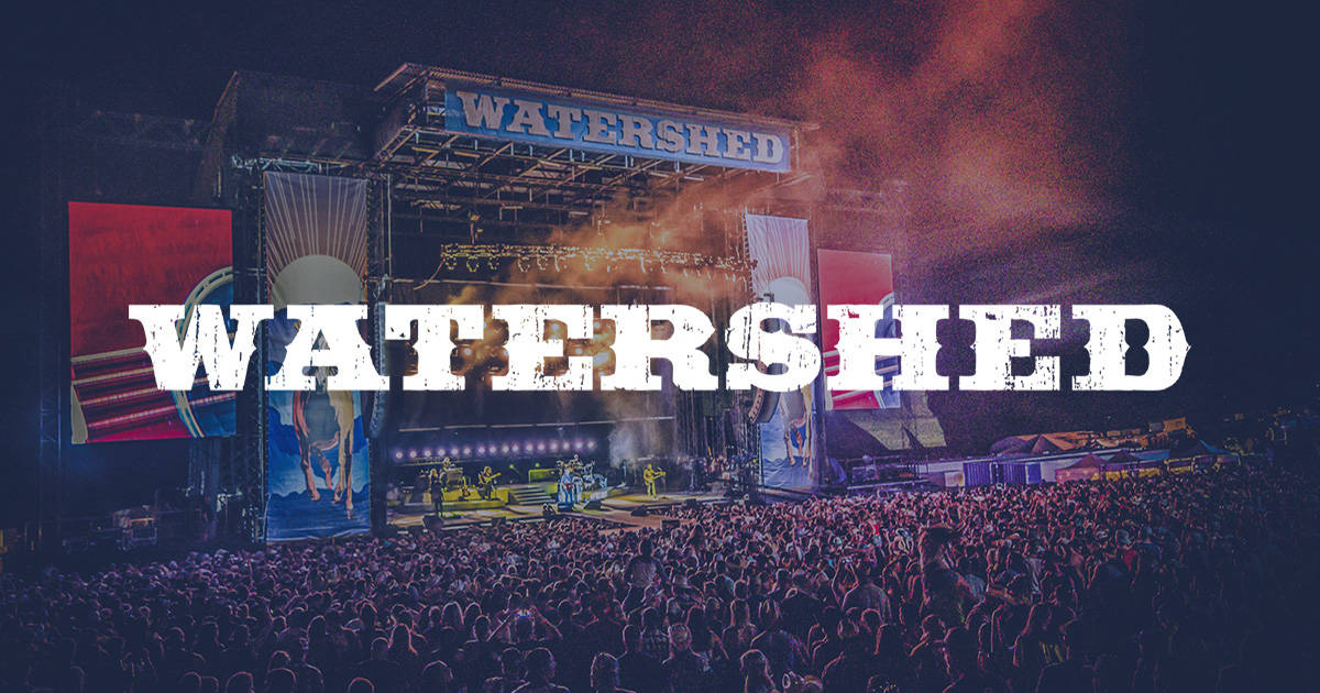 Watershed spelled out with concert in background